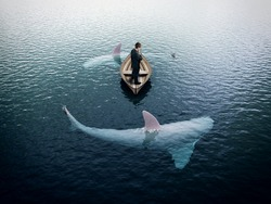 businessman thinking and sharks around him