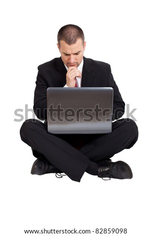 Businessman thinking and sitting on the floor. Isolated on white background