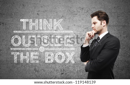 businessman thinking and think outside the box