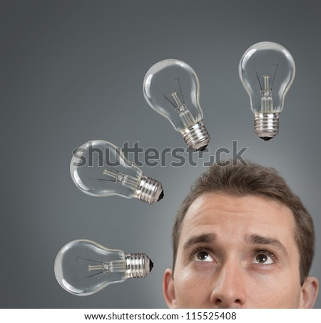 Businessman thinking concept with a light bulbs of