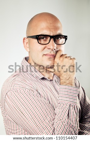 Businessman thinking with his hand on chin