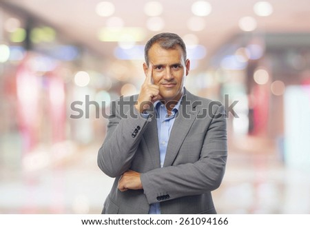 businessman thoughtful in the shopping center #261094166