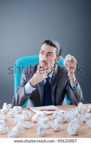 Businessman throwing paper away