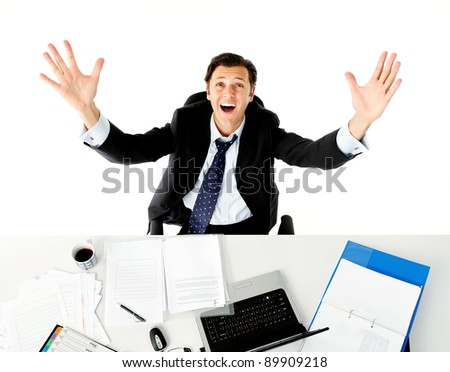 Businessman throws his arms up in frustration when he does paperwork