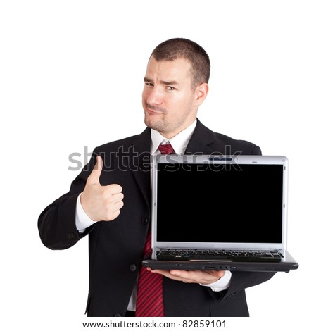 Businessman thumb up and holding laptop with blank screen. Isolated on white background
