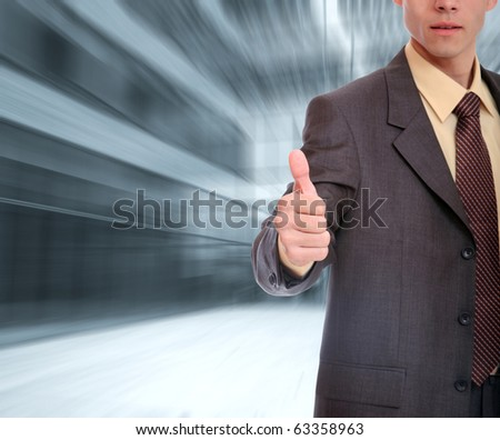 Businessman thumbs up hand sign
