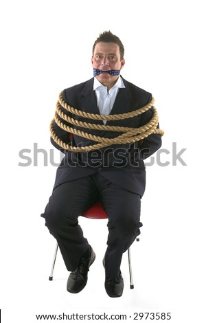 Businessman tied up with rope and gagged with his own tie.