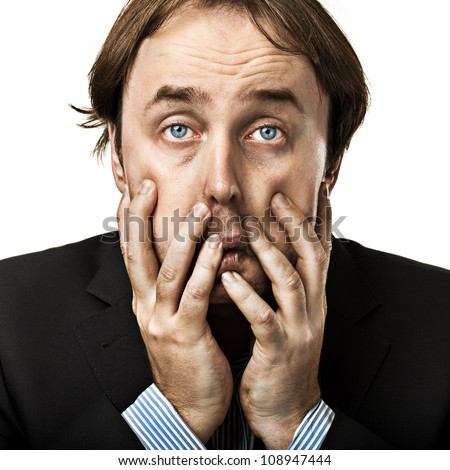 Businessman tired from crisis and working with hands over face