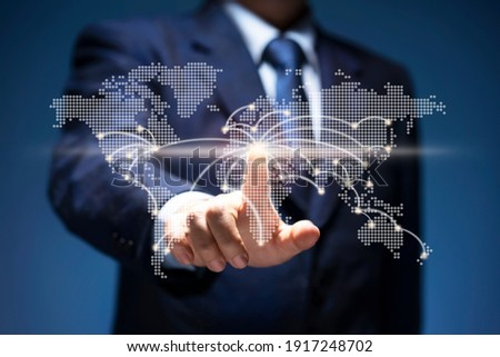 Businessman touch point of city connection line in world map. Man press button on virtual screen of planet earth show start up, business plan, communicate, technology, global network, internet concept Foto d'archivio ©