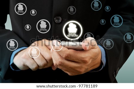 Businessman touch smart phone in hand with social network