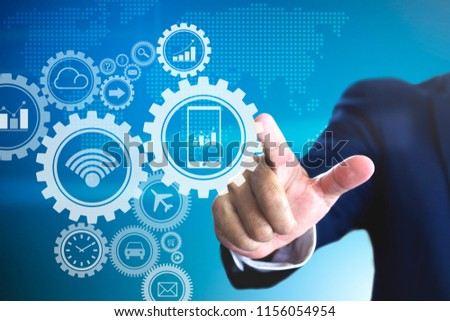 Businessman touch to force virtual gears for a concept of business driving and market mechanism Foto d'archivio ©
