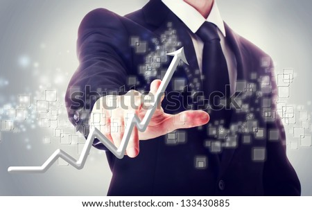 Businessman Touching a Arrow Indicating Growth