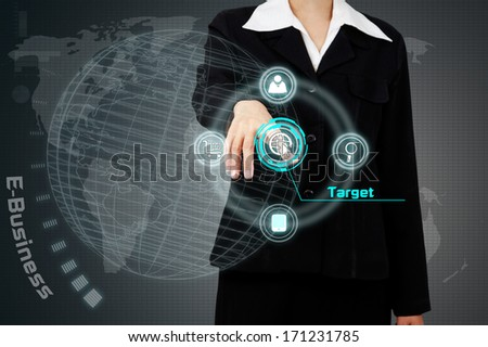 Businessman touching a business target on virtual screen.