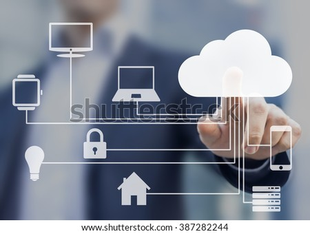 Businessman touching a cloud connected to many objects on a virtual screen, concept about internet of things #387282244