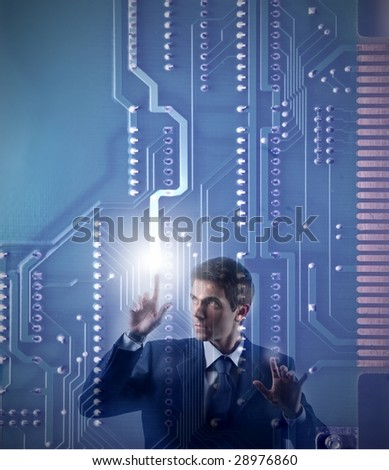 businessman touching a digital motherboard
