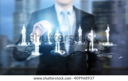 Businessman touching businessperson silhouette icon on networking system #409968937