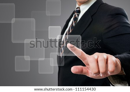 Businessman touching button
