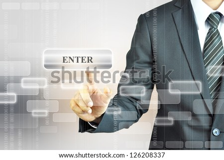 Businessman touching Enter sign