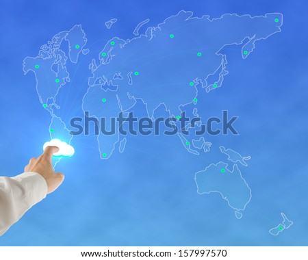 Businessman touching glowing cloud with worldwide map background in blue sky