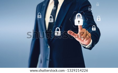 Businessman touching padlock virtual button. The concept of success in business. #1329214226