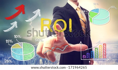 Businessman touching ROI (return on investment) over skyline background