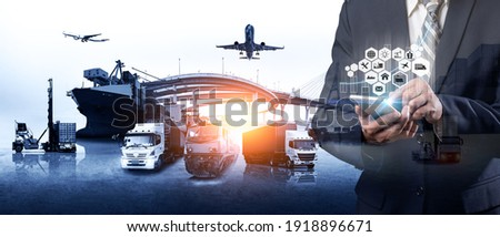 Businessman touching smartphone for analyze stock at logistics port and world map and online goods orders ,logistics network import export transportation trading business concept ストックフォト ©