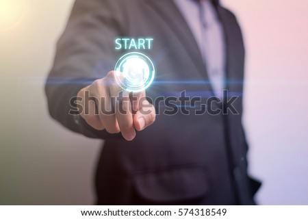 Businessman touching virtual button start