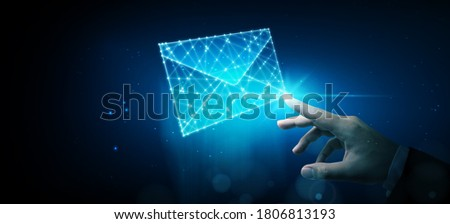 Businessman touching wireframe e-mail. Email marketing, newsletter, contact us concept Zdjęcia stock ©