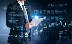 Businessman trader in suit using tablet with business report hologram. Business and financial success concept. double exposure. Forex Chart