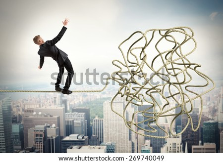 Businessman trying to solve a confusing problem