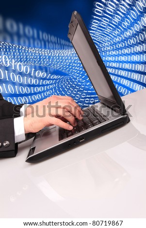 Businessman typing on laptop with binary code on background