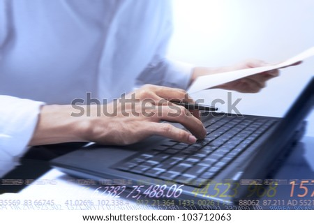 businessman typing on notebook and running numbers