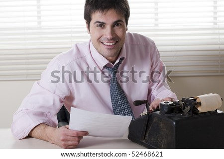 Businessman typing on old typewriter