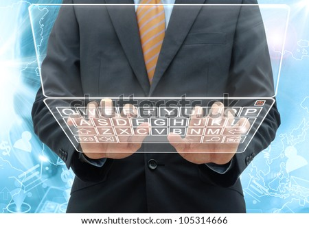 businessman typing the keyboard on glass computer