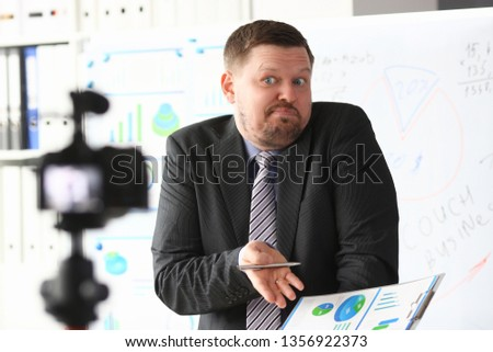 Businessman uncertain blogger online coach screaming intro camera bad news concept #1356922373