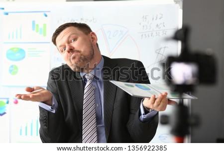 Businessman uncertain blogger online coach screaming intro camera bad news concept #1356922385