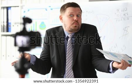 Businessman uncertain blogger online coach screaming intro camera bad news concept #1356922391