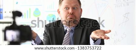 Businessman uncertain blogger online coach screaming intro camera bad news concept #1383753722