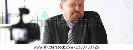 Businessman uncertain blogger online coach screaming intro camera bad news concept #1383753725