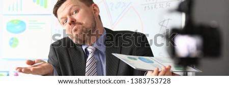 Businessman uncertain blogger online coach screaming intro camera bad news concept #1383753728
