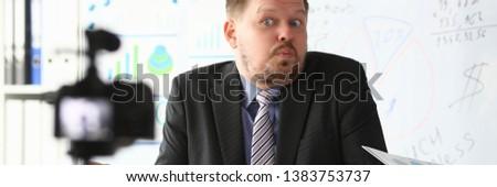 Businessman uncertain blogger online coach screaming intro camera bad news concept #1383753737