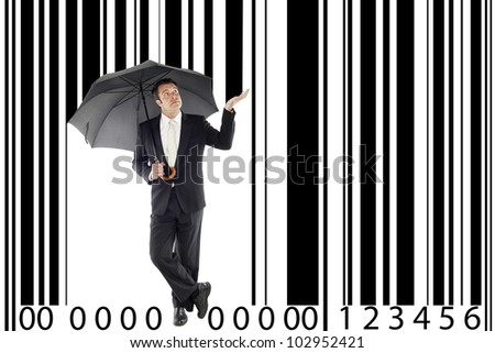 businessman under one umbrella, in between a large bar-code, metaphor boss, manager, consumerism ... - stock photo
