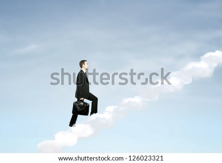 businessman up stairs out of clouds