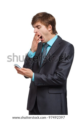 businessman use communicator, mobile phone, yawning, cover mouth by hand using cellphone, handsome young business man dial number phone call, wear elegant suit isolated over white background