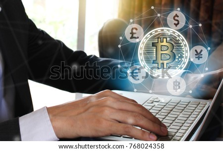 Businessman use Laptop with virtual screen bitcoin and fintech, virtual currency blockchain technology concept, Internet Concept of global business.