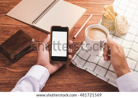 Businessman use smartphone in morning time. First person view. Concept for business, morning lifestyle, application about business, coffee break. #481721569