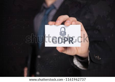Businessman Use Visiting Card And Selecting GDPR, Touch Screen. Virtual Icon. Graphs Interface. Business concept. Internet concept. Digital Interfaces #1161962737