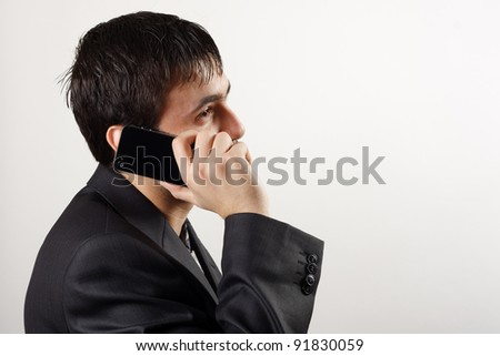 Businessman uses cell phone - stock photo
