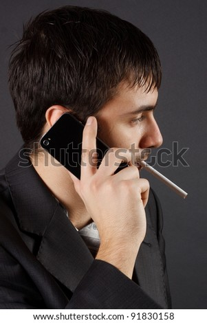 Businessman uses cell phone