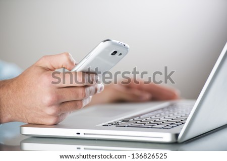 Businessman uses the new media technologies and devices to work successfully